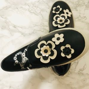 Black and white floral slip on sneakers